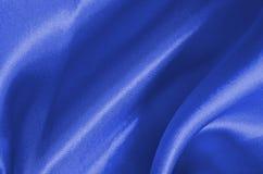 Голубая сатинировка текстуры шелк Стоковая Фотография