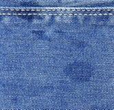 голубая текстура джинсыов джинсовой ткани Стоковая Фотография