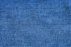 Голубая текстура конца ткани джинсовой ткани вверх Стоковая Фотография