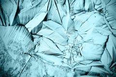 Голубая текстура льда, который замерли воды Стоковая Фотография