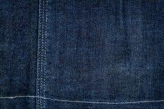 голубая темная текстура джинсыов Стоковое Изображение RF