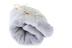 Голубое полотенце на белой предпосылке Стоковая Фотография RF