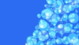 Голубое bokeh Стоковые Изображения