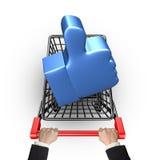 Голубой большой палец руки вверх в магазинной тележкае с удерживанием руки Стоковое Изображение
