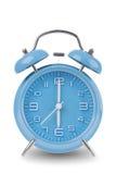 Голубой будильник изолированный на белизне Стоковое фото RF