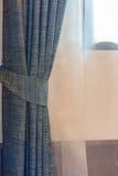 Голубой занавес окном Стоковое фото RF
