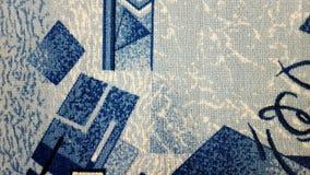 Голубой ковер шерстей с картиной Справочная информация стоковая фотография