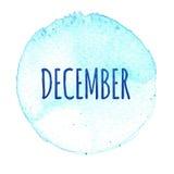 Голубой круг акварели с словом декабрем изолированный на белой предпосылке Стоковые Фото