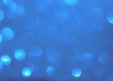 Голубой свет bokeh круги запачканные нежностью светлое белого и Стоковое Фото