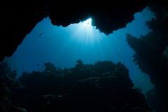Голубой солнечный свет и риф Стоковая Фотография