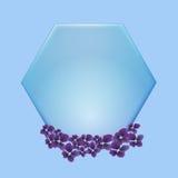 Голубой шестиугольник с фиолетовым flowwer на голубой предпосылке Стоковое фото RF