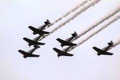 Голубые ангелы летая с следом дыма Стоковая Фотография