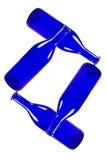 Голубые бутылки изолированные на белой предпосылке Стоковые Изображения