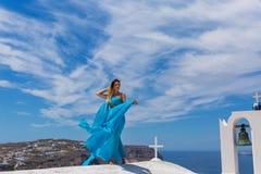 голубые детеныши женщины платья Стоковое фото RF