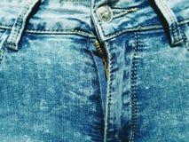 голубые джинсы предпосылки славные Стоковые Фото