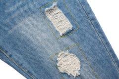 голубые джинсы сорвали Стоковое Фото
