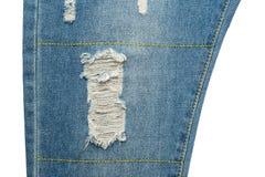 голубые джинсы сорвали Стоковое фото RF
