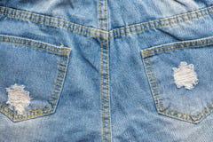 голубые джинсы сорвали Стоковые Фотографии RF
