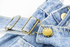 Голубые джинсы с латунными стержнями Стоковая Фотография