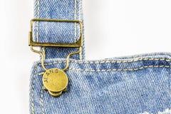 Голубые джинсы с латунными стержнями Стоковые Фото