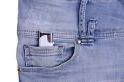 Голубые джинсы с лихтером Стоковые Изображения