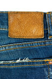 Голубые джинсы с кожаным ярлыком на белизне Стоковая Фотография RF