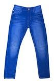 голубые изолированные джинсыы Стоковое фото RF