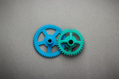 Голубые и зеленые шестерни Стоковые Изображения RF
