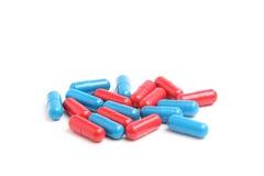 Голубые и красные пилюльки 3 Стоковая Фотография