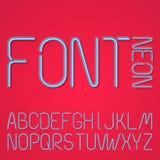 Голубые неоновые письма на красной предпосылке Стоковое фото RF