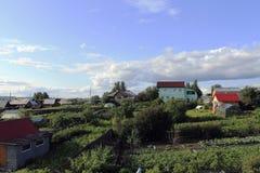 Голубые облака над деревней Стоковое Фото