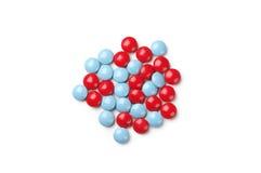 голубые пилюльки красные Стоковые Изображения RF