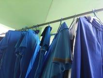 голубые рубашки стоковые изображения