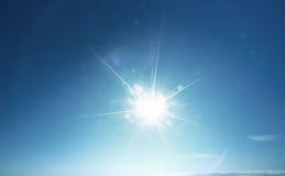 Голубые солнце и небо Стоковое Фото