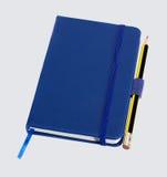 Голубые тетрадь и карандаш Стоковые Фото