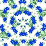 Голубые цветки и листья зеленого цвета Стоковые Изображения