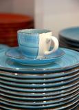 Голубые чашка и поддонник с плитами Стоковые Изображения