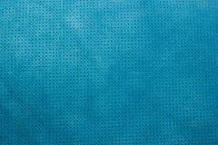 Голубым пефорированная бархатом кожаная предпосылка текстуры Стоковые Фото