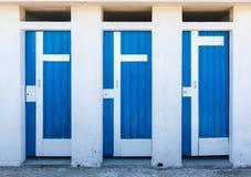 3 голубых двери Стоковые Изображения