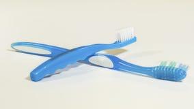 2 голубых зубной щетки на светлой предпосылке Стоковая Фотография RF