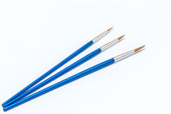 3 голубых кисти на белой предпосылке изолировано Стоковые Фотографии RF
