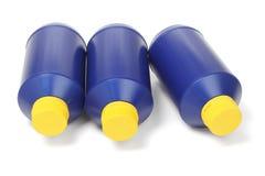 3 голубых пластичных бутылки Стоковое Изображение