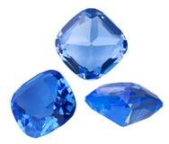 3 голубых сапфира на белизне Стоковое фото RF
