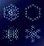 4 голубых снежинки на синем Стоковая Фотография