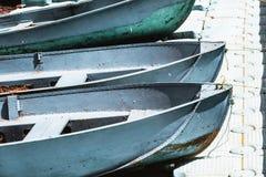 3 голубых шлюпки на набережной Стоковые Изображения RF