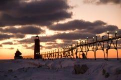 грандиозный заход солнца маяка гавани Стоковое фото RF