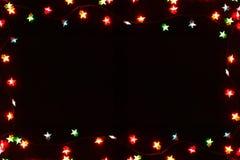 Граница светов рождества на черной предпосылке Стоковые Фотографии RF
