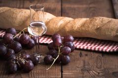 Граппа с виноградиной и хлебом Стоковые Фото
