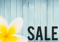 График продажи и желтый цветок против голубой деревянной панели Стоковое Изображение