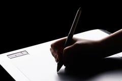 графическая таблетка руки Стоковые Фотографии RF